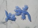 blue carved glass lizards
